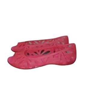 CROCS pink slip on flats size 7